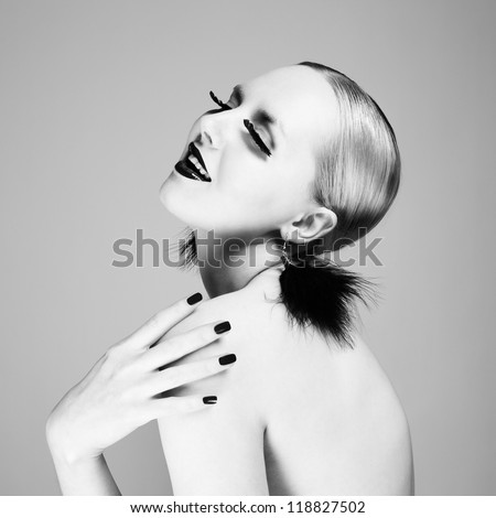 Photo of beautiful young woman with magnificent eyelashes. The Black-and-white photo