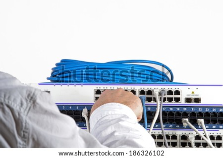 Photo of big server and wires during check-up - stock photo