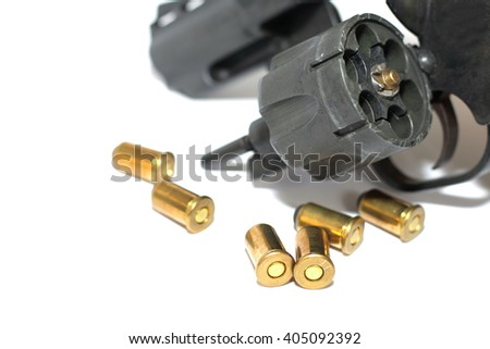 Photo of black revolver gun with cartridges isolated on white background - stock photo