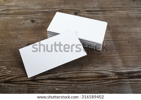 Photo of blank business cards on a wooden background. Template for ID. - stock photo