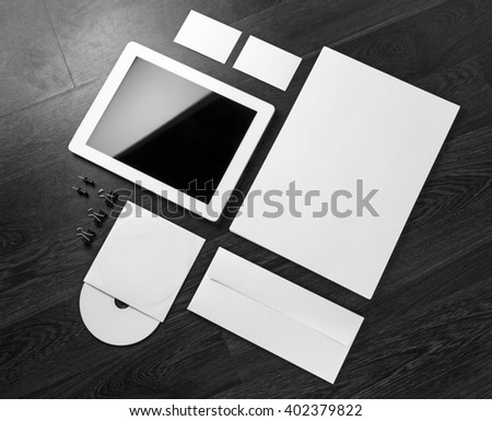 Photo of blank stationery and corporate identity template on dark wooden background. For design presentations and portfolios.