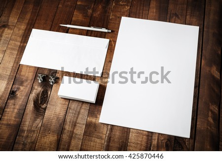 Photo of blank stationery set on vintage wooden table background. Mockup for branding identity. Blank branding identity set. Identity template. For designers portfolios. - stock photo