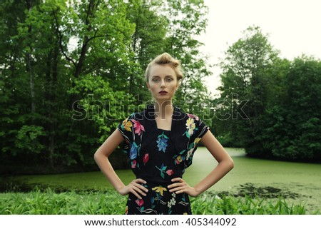 Photo of Blonde Woman near the Lake - stock photo
