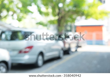 Photo of blurred parking cars in around office - stock photo