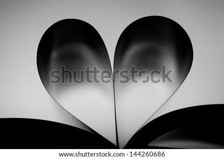 Photo Of Book With Hart Shaped Pages, Back Lit. - stock photo