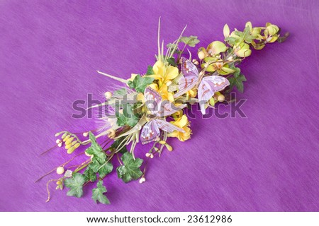 Photo of bouquet of artificial flowers isolated on textured red background
