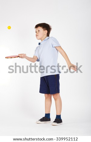 photo of boy playing table tennis on white - stock photo