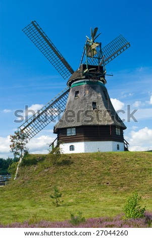 Photo of brick windmill in Europe and blue sky