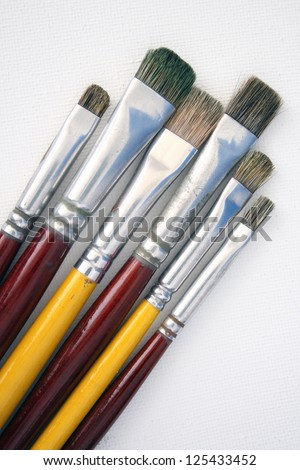 Photo of Brushes on canvas