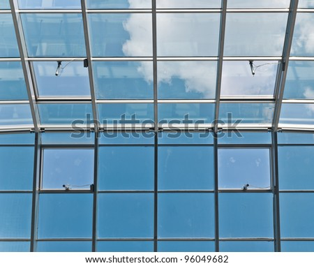 Photo of business center glass ceiling with window motors - stock photo