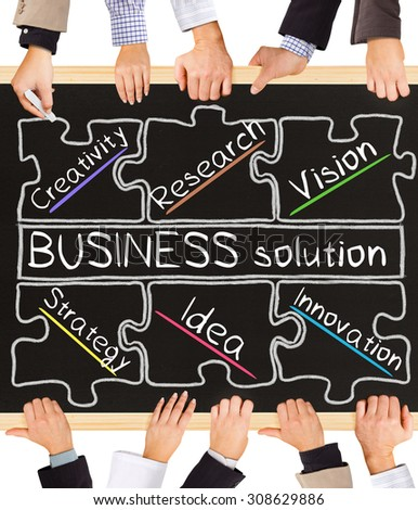 Photo of business hands holding blackboard and writing BUSINESS solution diagram - stock photo