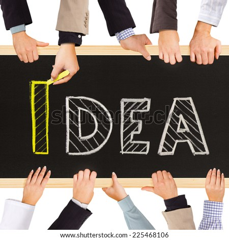 Photo of business hands holding blackboard and writing IDEA concept - stock photo