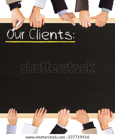 Photo of business hands holding blackboard and writing Our Clients - stock photo