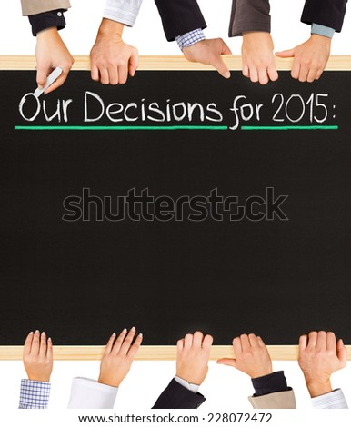 Photo of business hands holding blackboard and writing Our Decisions for 2014 - stock photo