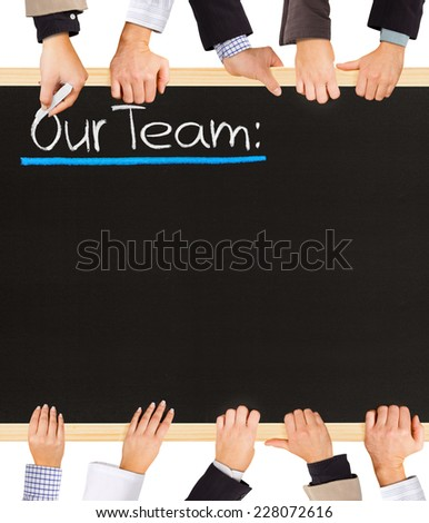 Photo of business hands holding blackboard and writing Our Team - stock photo