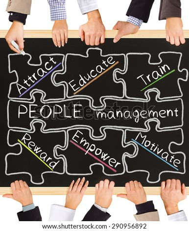 Photo of business hands holding blackboard and writing People Management Schema