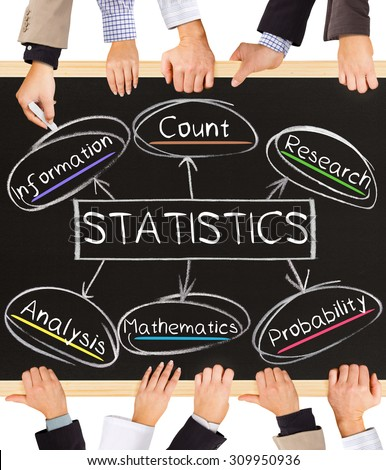 Photo of business hands holding blackboard and writing STATISTICS concept - stock photo