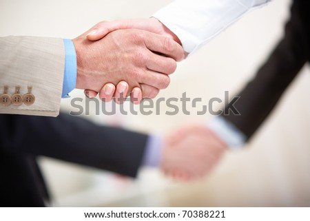 Photo of business handshakes in line