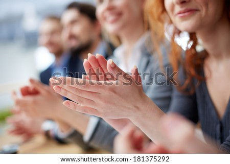 Photo of business people hands applauding at conference - stock photo