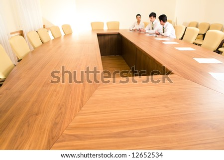 Photo of business people sitting at table in the boardroom and working together - stock photo