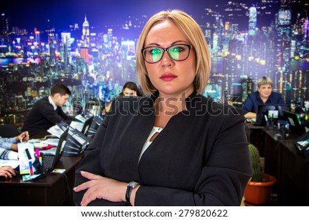 Photo of business woman in glasses in office - stock photo