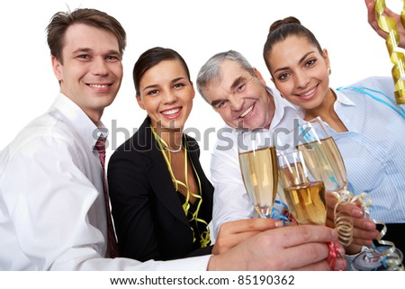 Photo of businesspeople cheering up their flutes filled with sparkling champagne