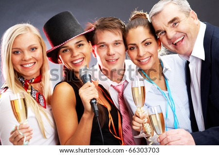 Photo of businesspeople with flutes of champagne celebrating Christmas - stock photo