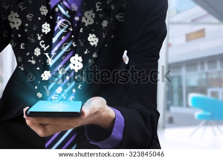 Photo of businessperson hand holding mobile phone with currency sign coming out from the screen - stock photo