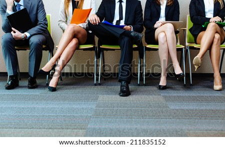 Photo of candidates waiting for a job interview - stock photo