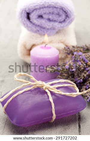 Photo of candle and lavender soap over wooden table - stock photo