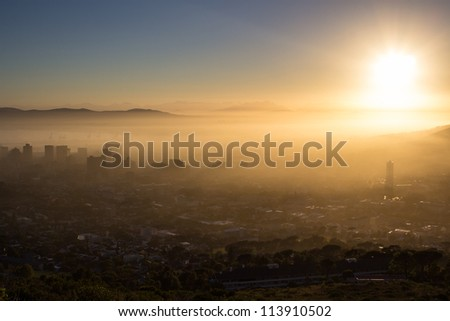 Photo Of Cape Town On A Misty Morning With Buildings Looking Through The Fog - stock photo