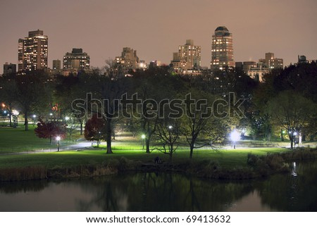 Photo  of Central Park in NYC taken at night. - stock photo