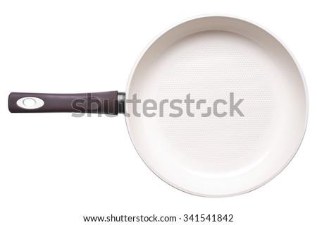 Photo of ceramic frying pan isolated on white background. Studio shot - stock photo