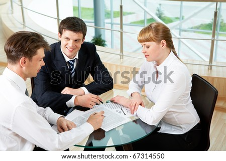 Photo of company of successful people discussing new project in office - stock photo