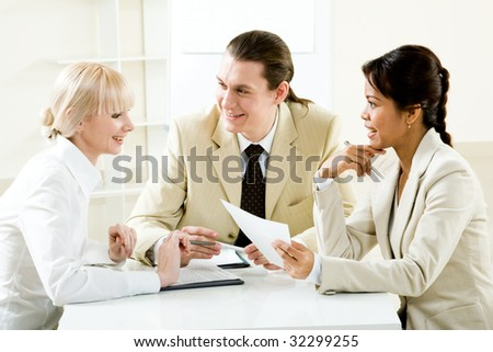 Photo of company of successful people planning work in office - stock photo
