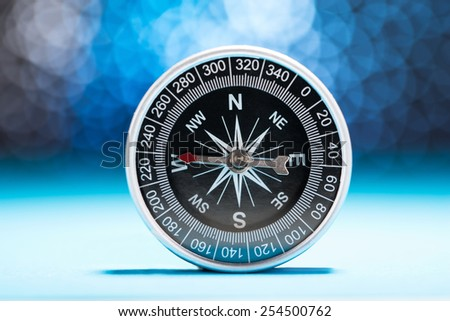 Photo Of Compass Needle Pointing To West Direction - stock photo