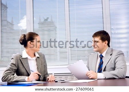 Photo of confident business partners looking at each other during formal communication - stock photo
