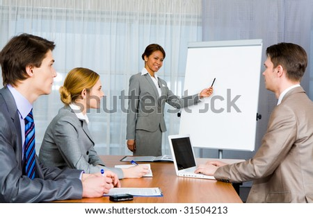 Photo of confident employer teaching business people how to manage organization
