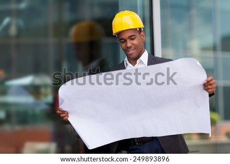photo of construction engineer with blueprints - stock photo
