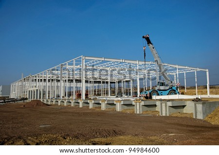 Photo of construction site of modern warehouse - stock photo