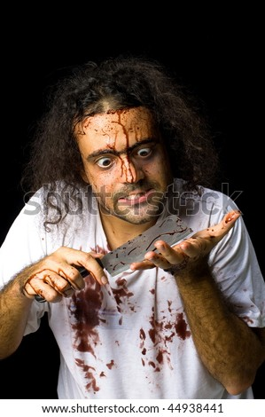 Photo of Crazy Butcher holding a knife . - stock photo