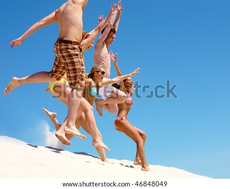 Photo of crowd jumping and screaming outdoor - stock photo