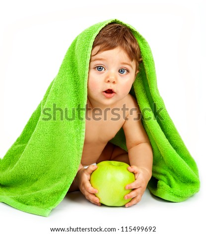 Photo of cute little boy eating big fresh apple, adorable child covered green towel isolated on white background, closeup portrait of cheerful kid enjoying healthy nutrition, health care concept - stock photo