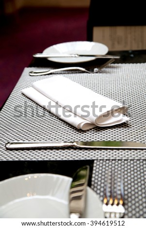 photo of cutlery and napkin in a restaurant