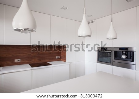 Photo of decorative lighting in contemporary style kitchen interior