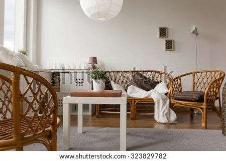 Photo of decorative wicker furniture set in lounge