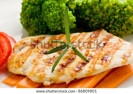 photo of delicious grilled chicken breast with various vegetables - stock photo