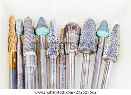 Photo of dental tools on isolated white background - stock photo