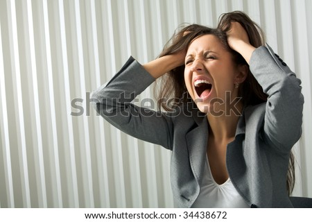 Photo of depressed female screaming in desperation - stock photo
