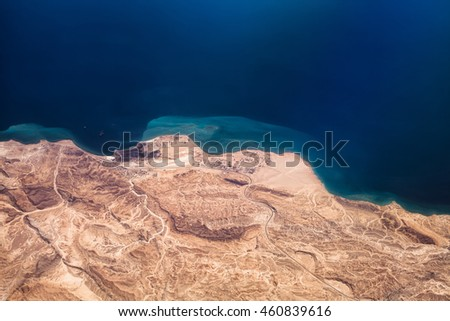 Photo of desert with sea and hot climate